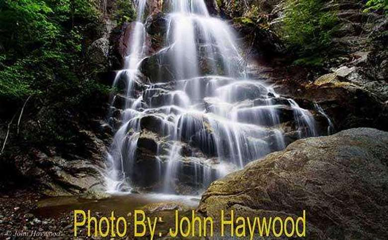waterfall running down a steep rock pile