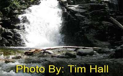 rushing waterfall with photo credit to tim hall