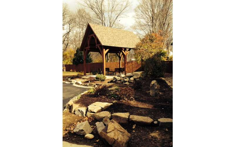 The back yard features a beautiful gazebo with a year-round fireplace- a nice evening gathering area.