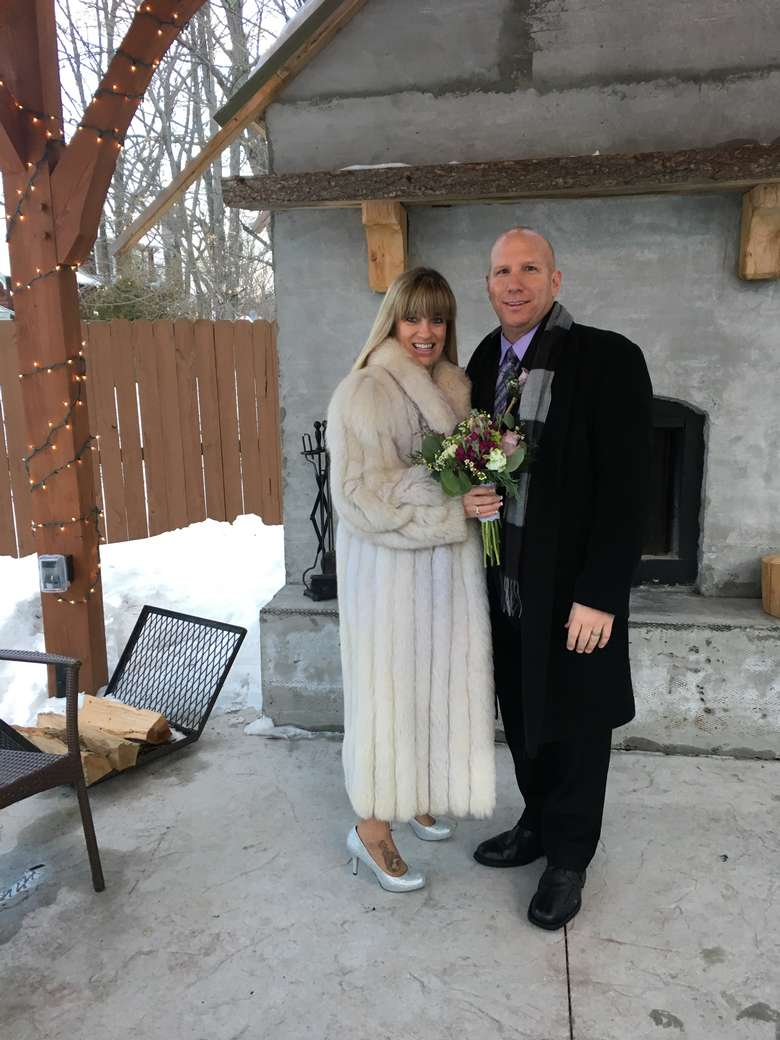 couple outside of Alpine Lodge
