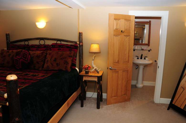 bedroom and bathroom at Alpine lodge