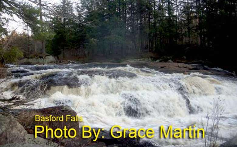 wide, shallow waterfall dropping down a few tiers with photo credit to grace martin