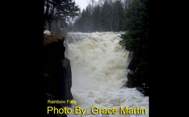 rushing waterfall with photo credit to grace martin
