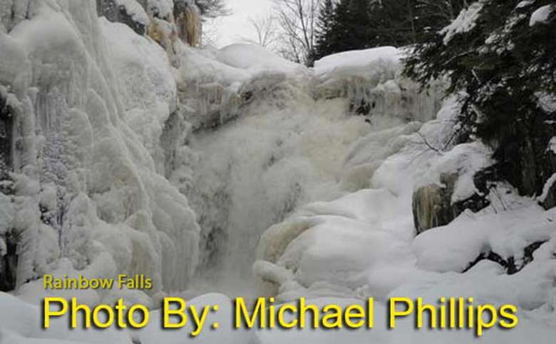 mostly frozen waterfall with photo credit to michael phillips