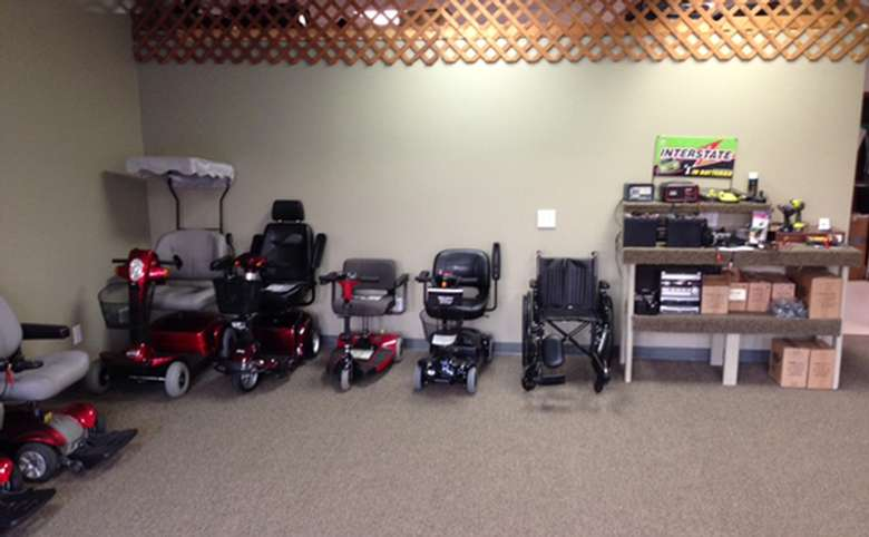 different types of wheelchairs and motorized scooters lined up