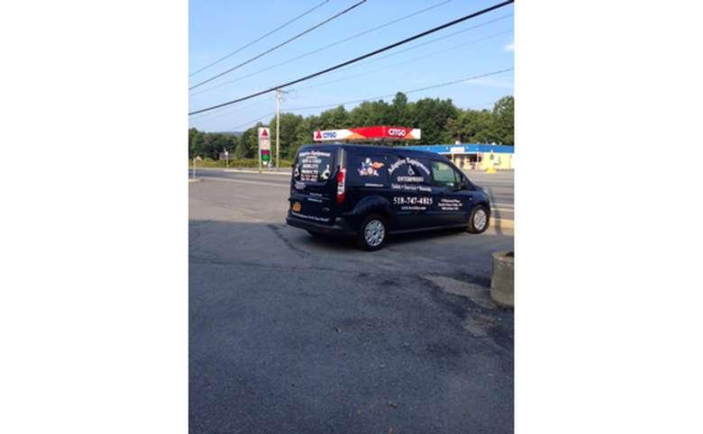 adaptive equipment enterprises van in a parking lot