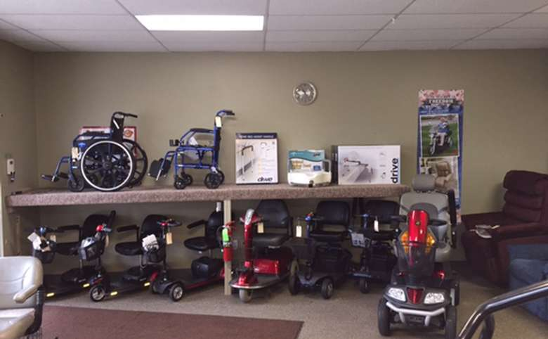 display of different types of wheelchairs and motorized scooters