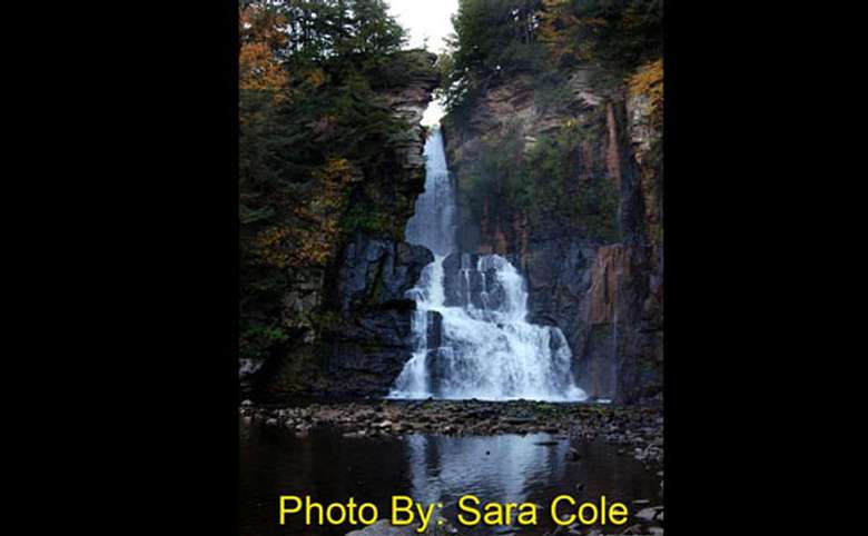 steep waterfall that widens as it drops with photo credit to sara cole