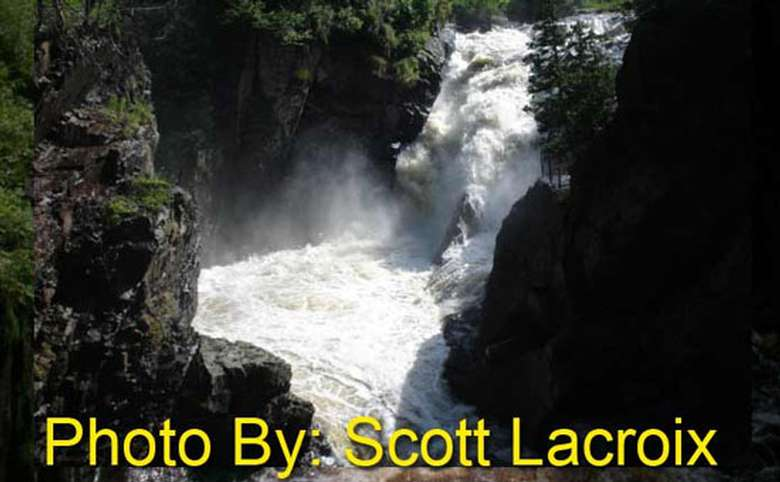 rushing waterfall dropping into a pool with photo credit to scott lacroix
