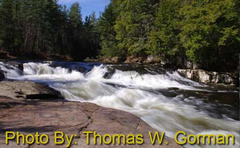 shallow rushing waterfall with photo credit to thomas w. gorman