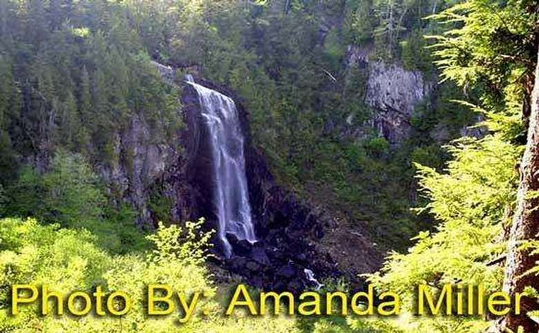 large waterfall in the woods with photo credit to amanda miller