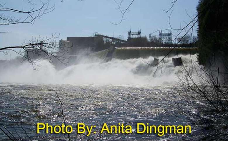 water flowing out of a hydroelectric plant with photo credit to anita dingman