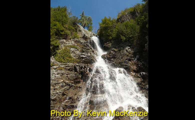view from below of a tall waterfall
