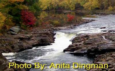 small waterfall with photo credit to anita dingman