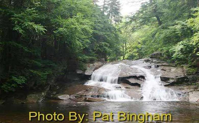 water flowing over rocks into a pool with photo credit to pat bingham