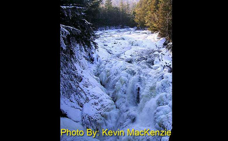 frozen waterfall with photo credit to kevin mackenzie