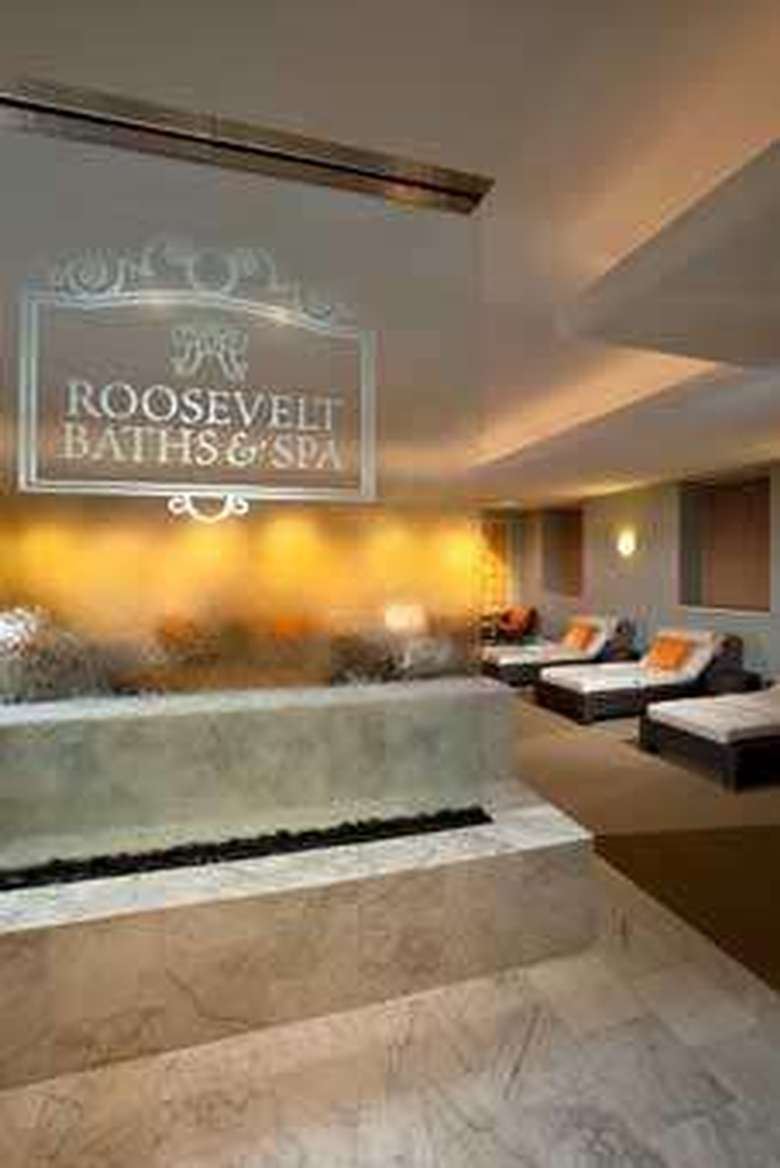 large glass panel with the roosevelt baths and spa logo carved into it