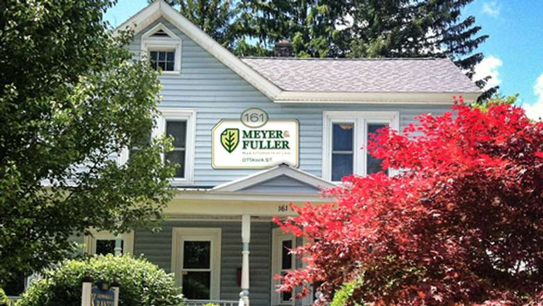 a house with the sign for meyer and fuller on the front of it