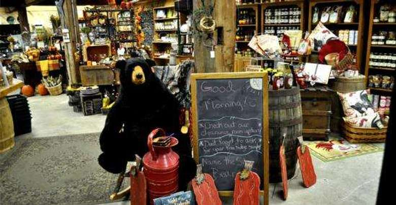 interior of the silo country store with a stuffed black bear, a welcome sign, and shelves full of preserves