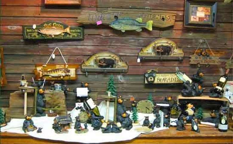 wooden fish and bear-themed signs and figurines