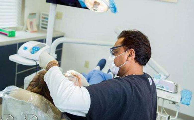 dentist working on a patient's mouth