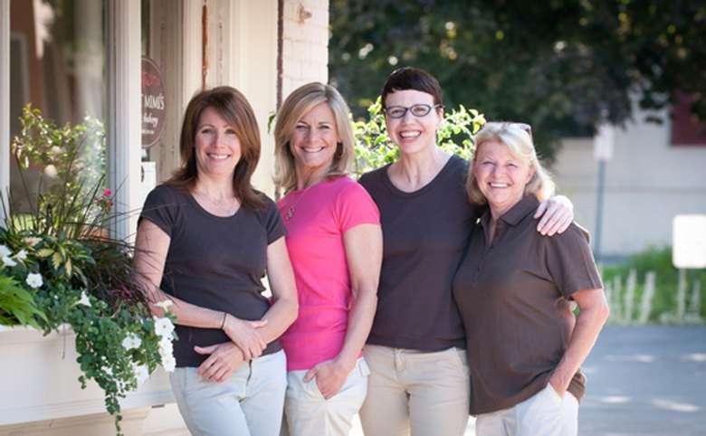 four women standing outside sweet mimi's