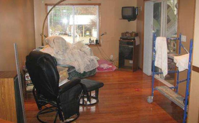 Messy room with worn furniture