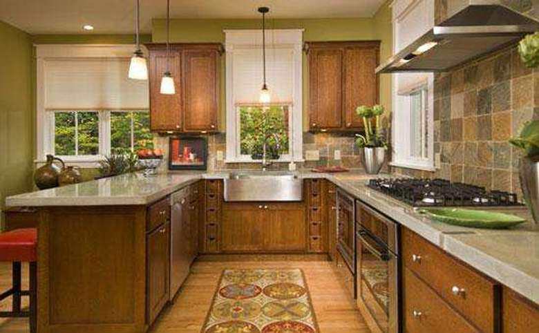 kitchen in a new house with a slate backsplash and stone countertops