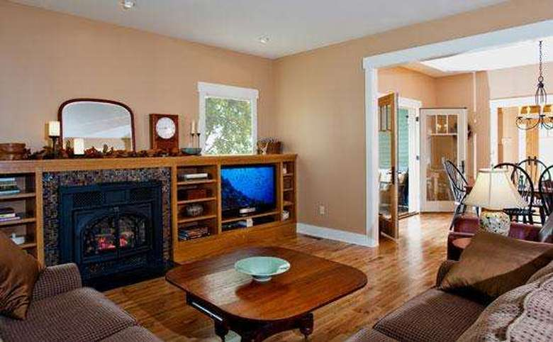 living room in a new house with built-in cabinetry surrounding the fireplace