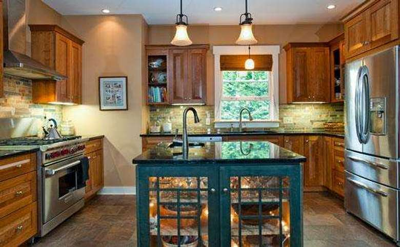 new kitchen with an island and stainless steel appliances