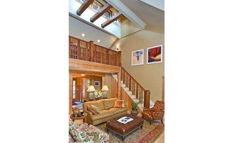 living room with a stairway leading up to the second story