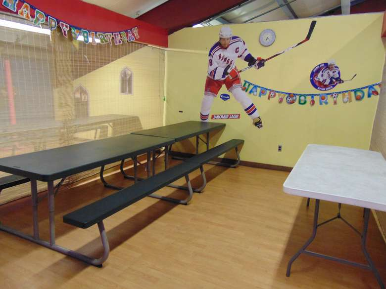 birthday party room at adventure family fun center decorated with hockey theme