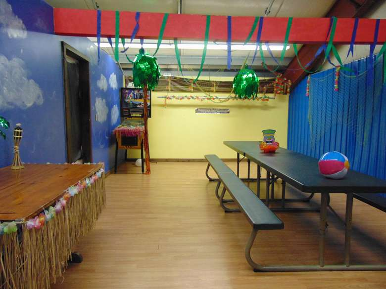 birthday party room at adventure family fun center decorated with beach theme