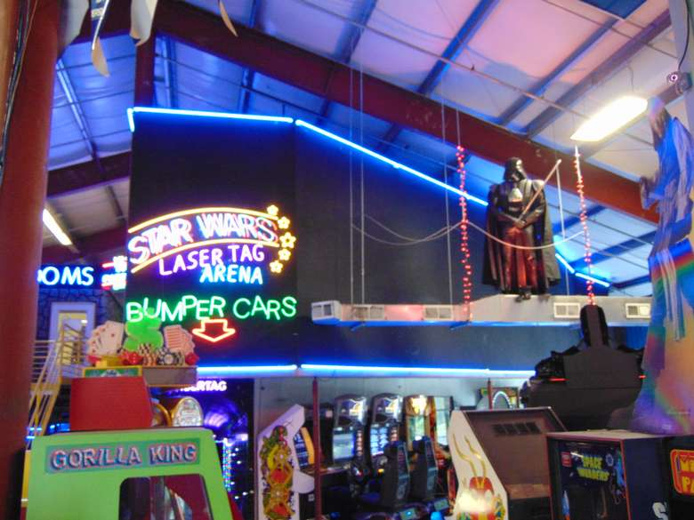 arcade games and sign for laser tag arena