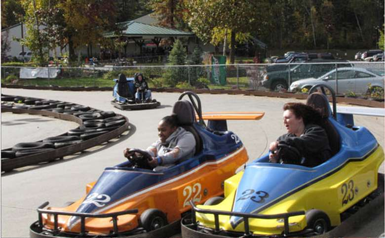 people driving go karts