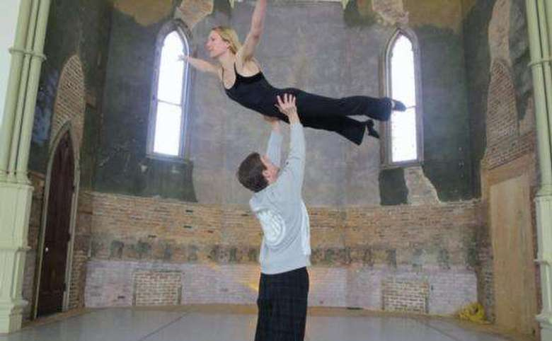 man holding a woman up in the air