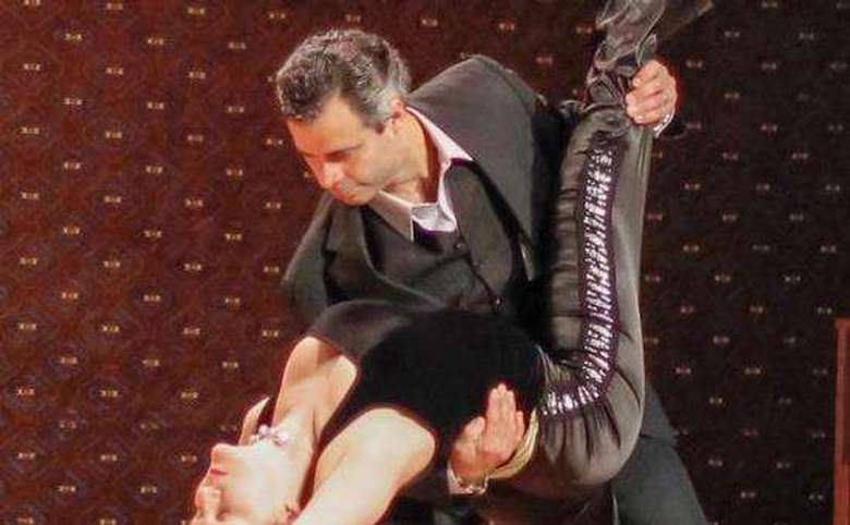 man dipping a woman during a ballroom dance performance