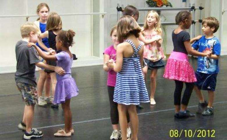 group of kids in a ballroom dance class