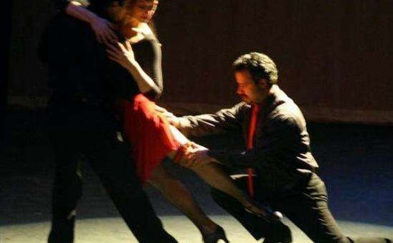 three people ballroom dancing on stage