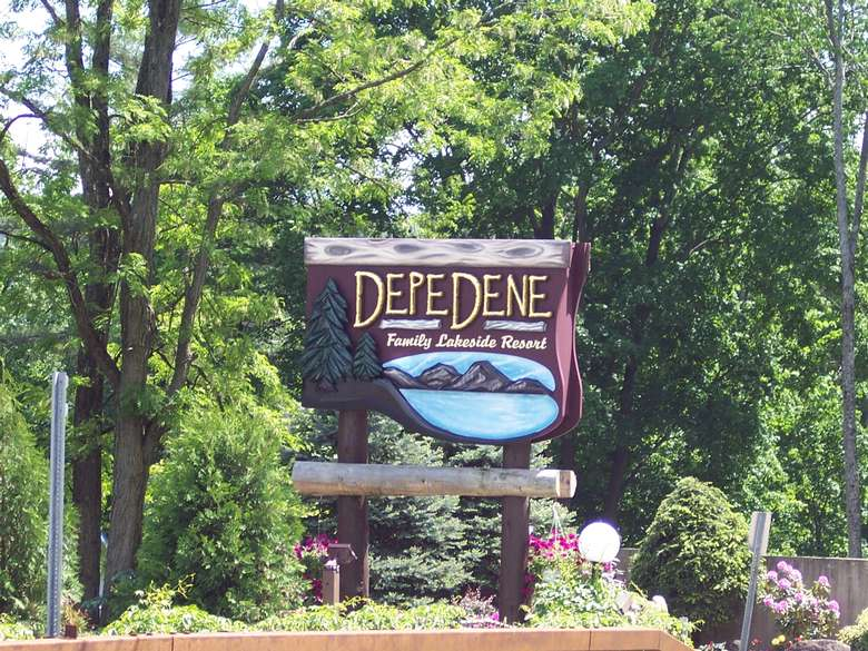depe dene sign surrounded by trees