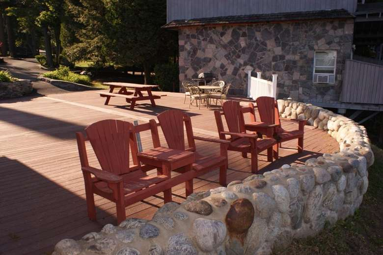 adirondack chairs on an outdoor patio