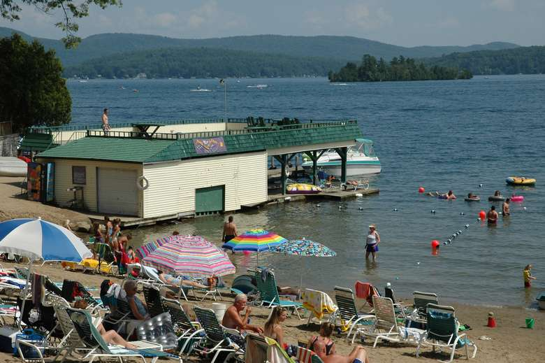 sandy beach and swimming area with boathouse on lake george