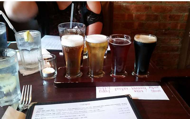 Craft Beer flight including: Alpine Hoppy Birthday, Maine Peeper, Founders Blushing Monk, Alpine Captain Stout