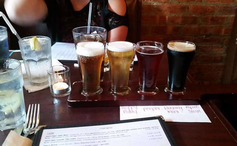 beer flight with four different types of beer