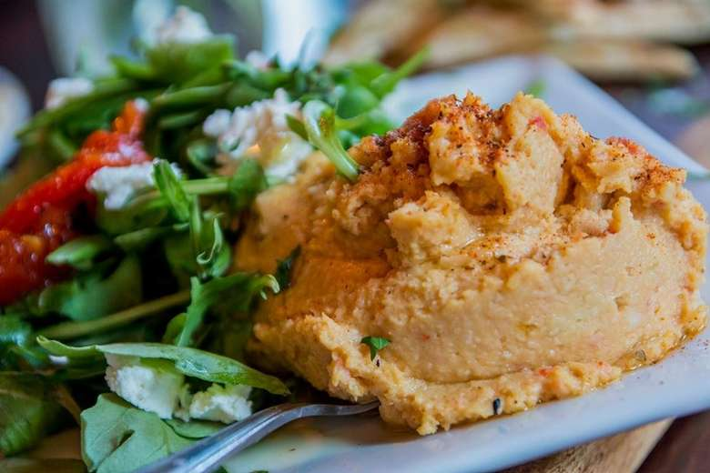 Sweet Potato Hummus on a white plate