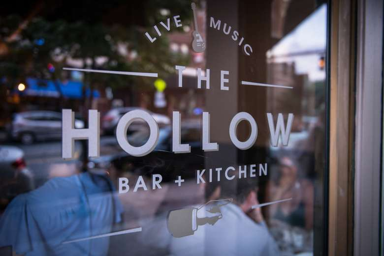front window of the hollow bar + kitchen with its logo etched into the glass