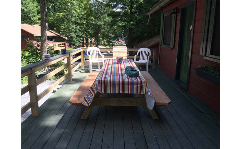 picnic table with striped tablecloth on deck