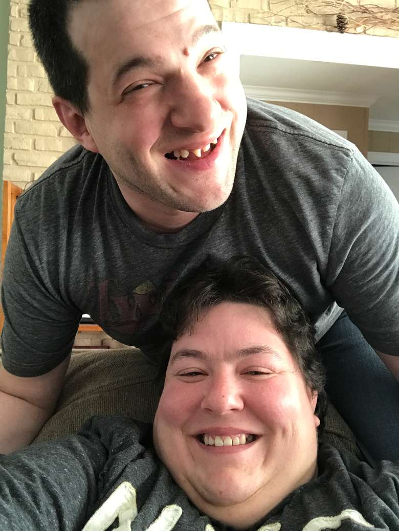 A man and a woman smiling for the camera