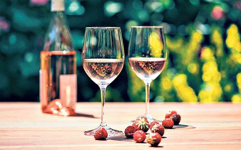 two glasses and a bottle of rose wine