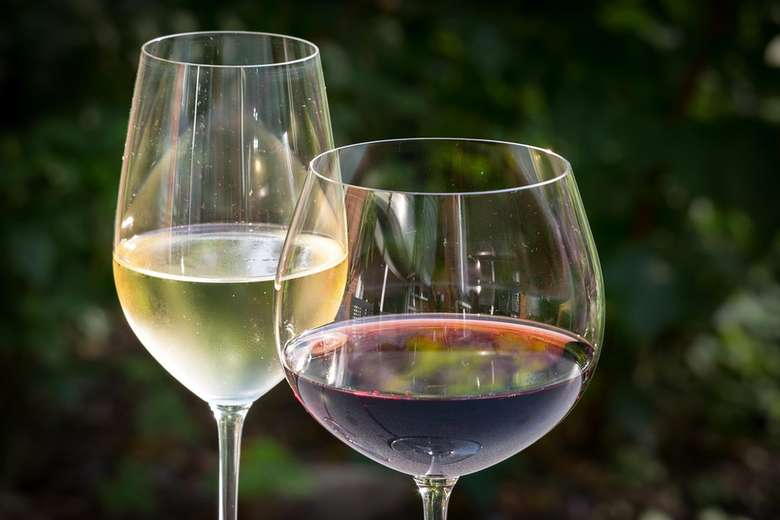 two glasses of wine, one red and one white